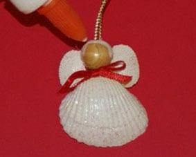 Рождественский ангел из ракушек 6