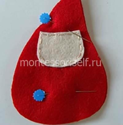 Пришиваем лицо и сметываем красные заготовки
