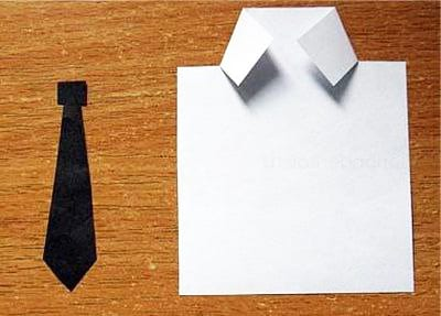Складываем ворот рубашки и вырезаем галстук