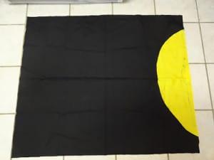 Черная ткань с солнцем