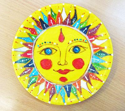 Солнышко с цветными узорами