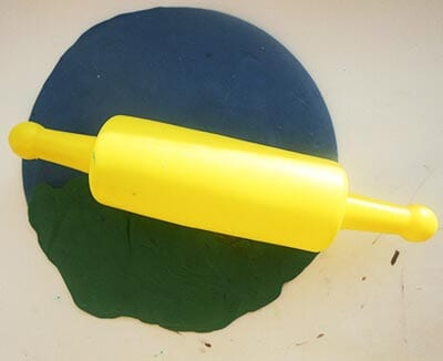 Align plasticine with a rolling pin