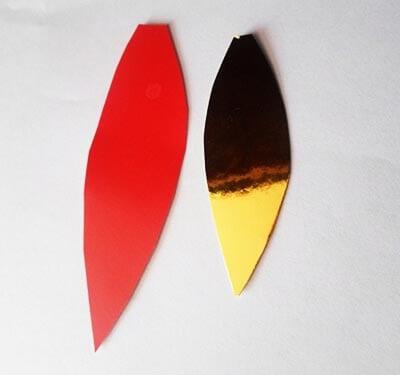 Вырезаем красный и золотистый огонек