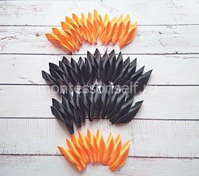 Лепесточки из черных и оранжевых лент